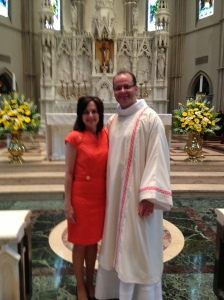 Deacon David and wife Karen in front of the altar at St. Paul Cathedral after ordination