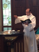 Deacon David during a baptism